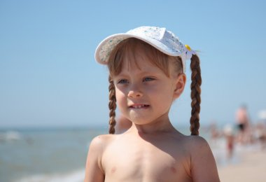 Portrait of a little girl playing on the beach.