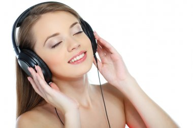 Beautiful girl with headphones listening music isolated on a white background stock vector