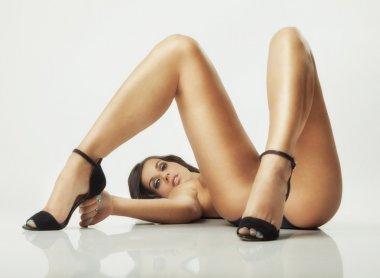 Glamour girl lying on floor