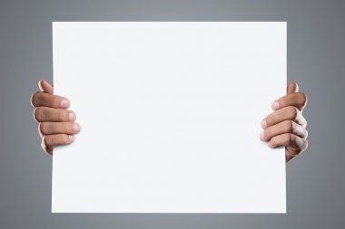Hands holding blank advertising card