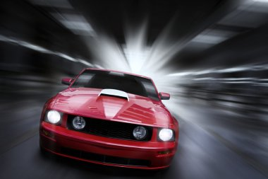Luxury red sport car speeding in a underground parking garage stock vector