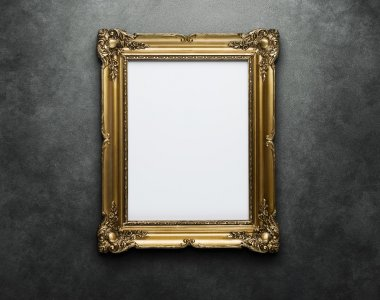 Blank golden frame at the wall with clipping path