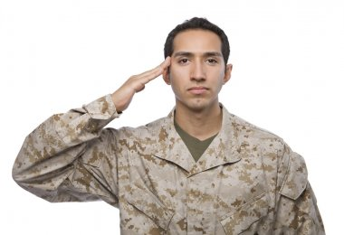Latino Male soldier in camouflage salutes