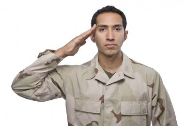 Hispanic military veteran salutes