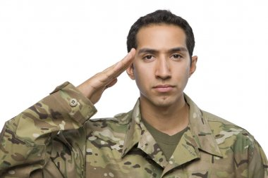 Hispanic Soldier salutes on white background