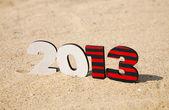 Fotografie dřevěné 2013 rok číslo na písku