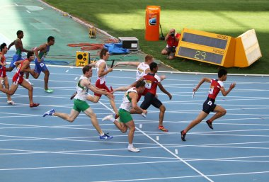 Athletes on the 4 x 100 meters relay race on the IAAF World Junior Championships on July 13, 2012 in Barcelona, Spain .