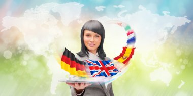 Young woman wearing suit holding tablet computer. Flags of Europ