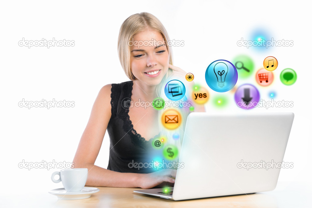 Young woman using her laptop for multimedia and site surfing. Di