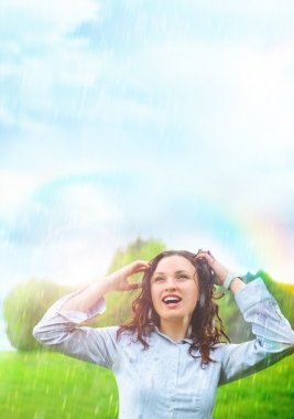 Young woman outdoors under rain against beautiful scenery. She is free and happy stock vector