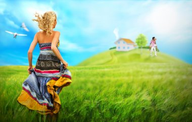Young woman running across field to house and family of her dream