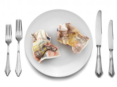 Euros Banknotes on white plate with knife and fork,