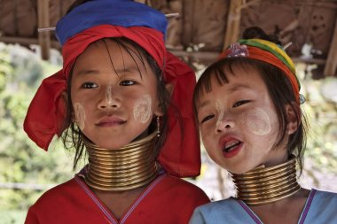 Thailand, Chiang Mai, Karen Long Neck hill tribe village (Kayan Lahwi), Long Neck young girls in traditional costumes. Women put brass rings on their neck when they are 5 or 6 years old and increase t