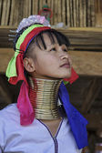 Photo Thailand, Chiang Mai, Karen Long Neck hill tribe village (Kayan Lahwi), Long Neck woman in traditional costumes. Women put brass rings on their neck when they are 5 or 6 years old and increase the num
