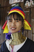 Fotografie Thailand, Chiang Mai, Karen Long Neck hill tribe village (Kayan Lahwi), Long Neck woman in traditional costumes. Women put brass rings on their neck when they are 5 or 6 years old and increase the num