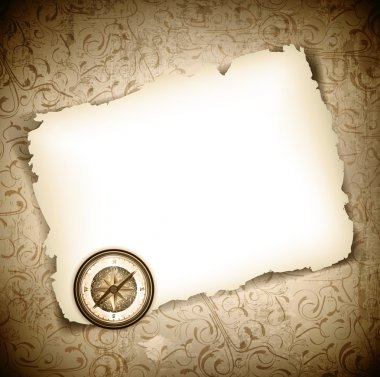 Vinatge antique compass at burned paper