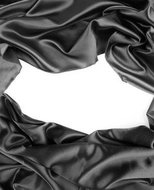 Closeup of gap in silk fabric on white