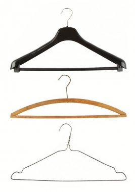 Coat hangers on plain background