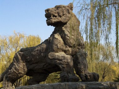 A stone lion is a common decoration of parks