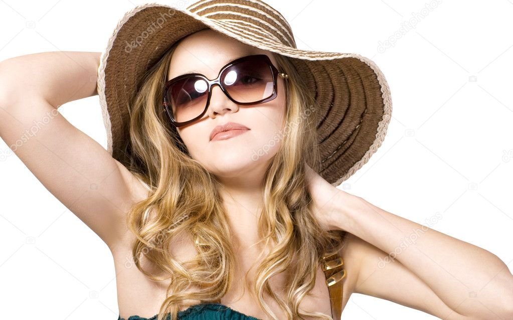 Beautiful model in hat with glasses