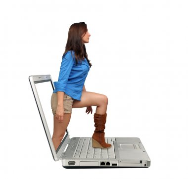 Beautiful Brunette Steps Out of a Laptop