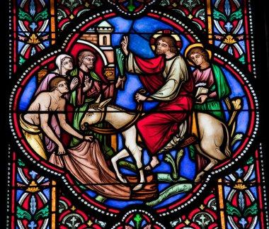 Jesus enters Jerusalem on a donkey on Palm Sunday.