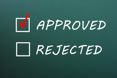 Check boxes for approved and rejected on a green chalkboard