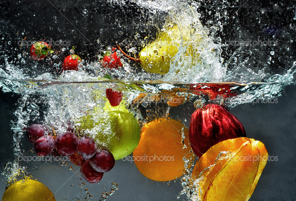 Fresh Fruit splashing into water