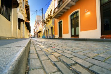 Cobblestone street viewed at a low angle in the Old City of San Juan, Puerto Rico. stock vector