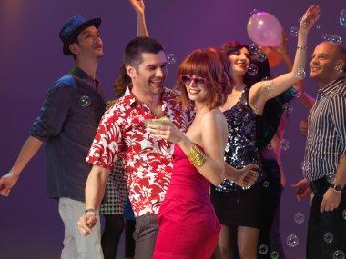 Sexy couple dancing, flirting in night club