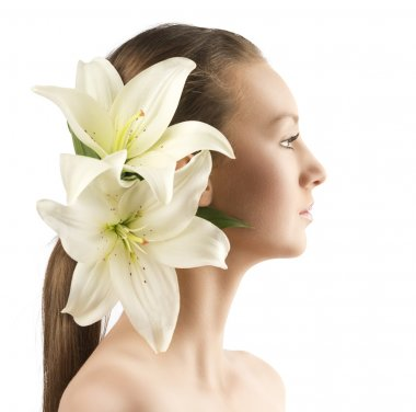 Beauty portait of pretty young girl with lilies, the girl is turned in profile at left and has lilies in the hair near the right ear stock vector