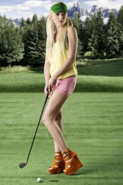 Sexy golf player woman, she looks at left