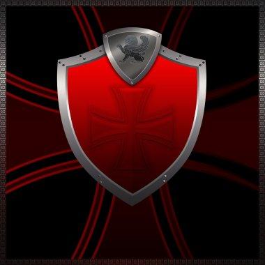 Silver red shield.