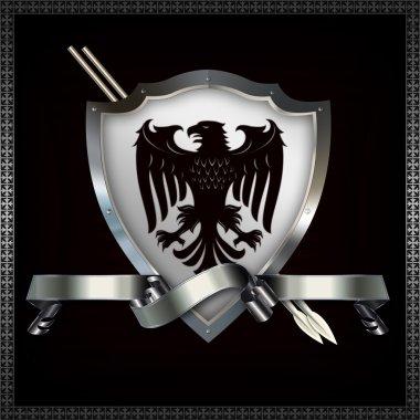 Heraldic shield and spears.