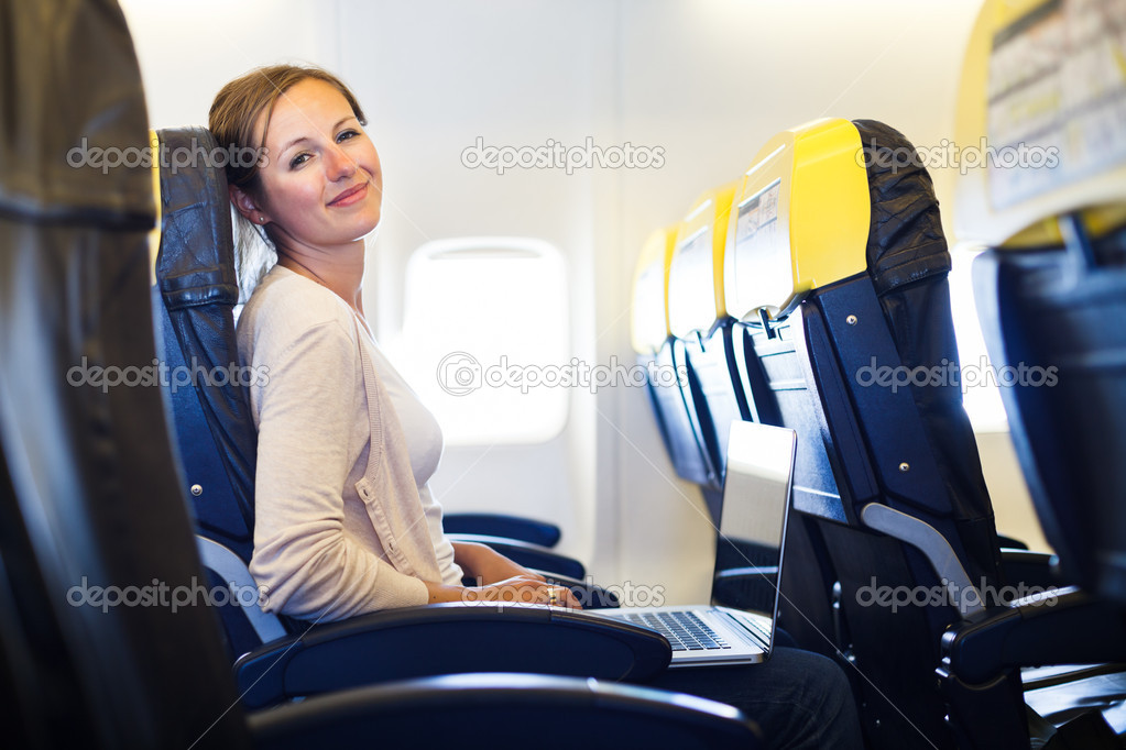 Just arrived: young woman at an airport having just left the air