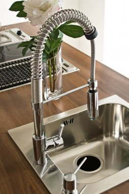 Modern kitchen counter, sink with flowers