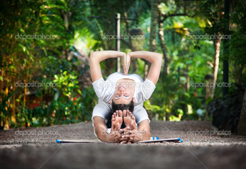 Couple yoga in garden