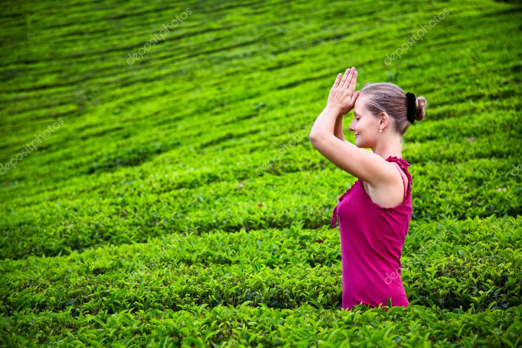 Praying woman in tea plantations