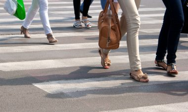 Feet on the pedestrian crossing