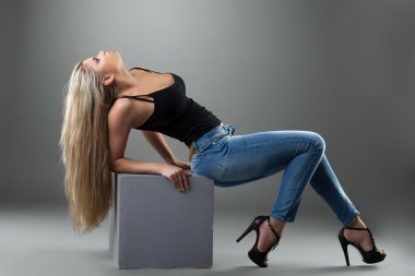 Sexy blonde woman in jeans