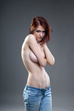 Sexy redhead woman in jeans