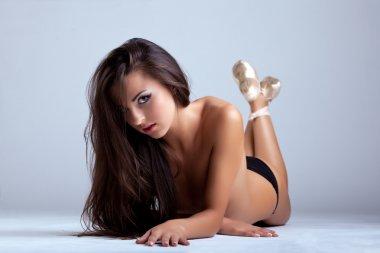 Sexy girl lay in black panties and ballet tiptoe