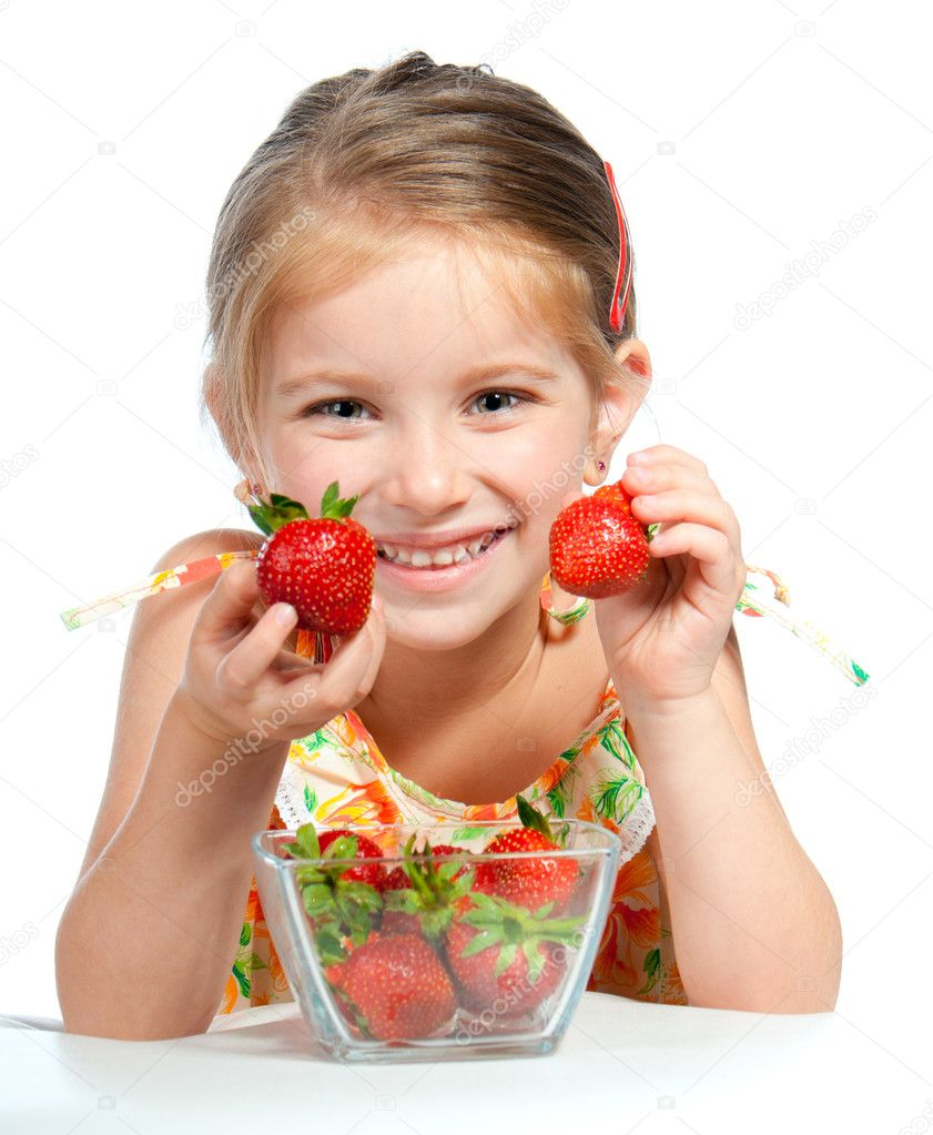 Little cute girl holding a strawberry