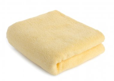 One yellow towel isolated on white