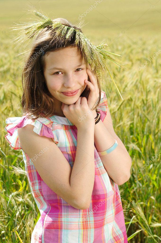 Young beautiful girl in a field of wheat stock photo for Teenage beautiful girls