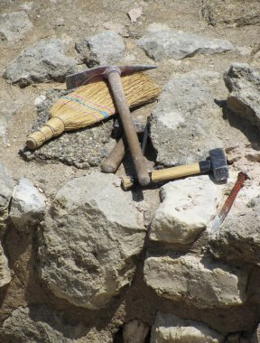 Archaeologist tools on excavation site