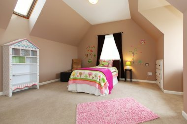 Baby girl kids bedroom with pink bed and brown walls.