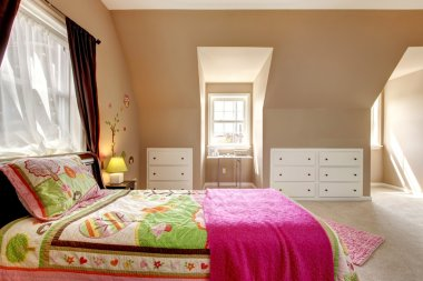 Large brown baby girl bedroom interior.