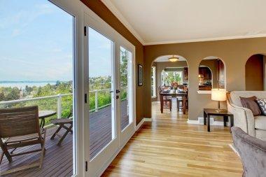 Luxury brown living room with hardwood floors.