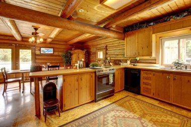 Log cabin wood kitchen with rustic style.